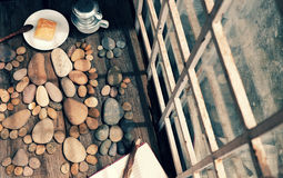 Coffee time,foot pebbles background. Relax morning for new day with coffee time in cafeteria, abstract cafe interior with table near glass window, pebbles Stock Image
