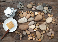 Coffee time,foot pebbles background. Relax morning for new day with coffee time in cafeteria, abstract cafe interior with table near glass window, pebbles Stock Photography