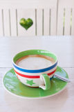 Coffee time in green garden with heart Royalty Free Stock Photography