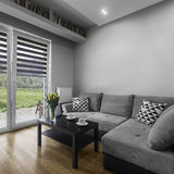 Coffee time in living room. Coffee time in modern living room in grey color royalty free stock images