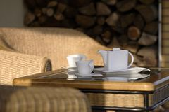 Coffee Time On The Patio 2. Pitcher and cups for coffee, sitting on a table of an outdoor patio royalty free stock image