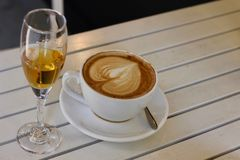 Coffee time and prosecco wine. A coffee cup with a glass of prosecco wine Stock Photos