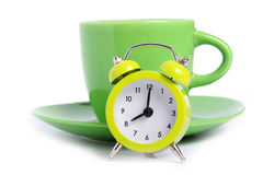 Coffee time. Small alarmclock and cup of coffe as concept for coffe time Royalty Free Stock Images