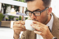 Coffee time. Sucessful  businessman enjoying in a cup of coffee Royalty Free Stock Image