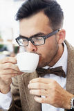 Coffee break. Sucessful  businessman enjoying in a cup of coffee Stock Photos
