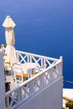 Coffee time on terrace in Santorini island Stock Image
