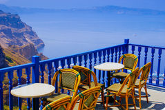 Coffee time on terrace in Santorini island Stock Images