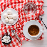 Coffee time. Treats and coffee on checkered cloth Royalty Free Stock Photo
