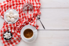 Coffee time. Treats and coffee on checkered cloth Stock Photo