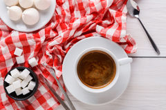 Coffee time. Treats and coffee on checkered cloth Stock Images