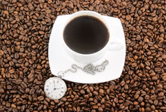 Coffee time, watch and cup on grains Royalty Free Stock Photos