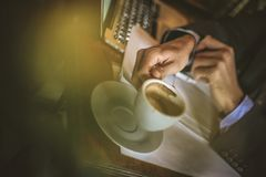 Coffee time. Young business man on coffee break. Close up. stock photography