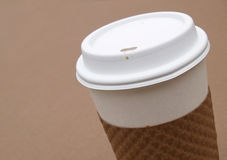 Coffee to go. Disposable coffee cup with protective cardboard holder Stock Photography