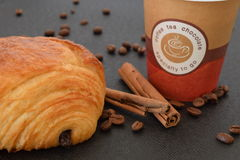 Coffee to go and croissant with coffee beans. Royalty Free Stock Images