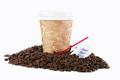 Coffee To Go Cup in Coffee Beans on White stock images