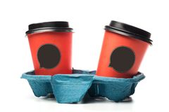 Coffee to go cups in carry tray including clipping path stock photo