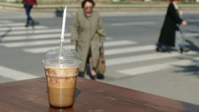Coffee to go with freshly made coffee on the edge of the table stock footage