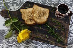 Coffee, toast and roses, romantic breakfast on Valentine's Day. Served on an wooden board with copy space royalty free stock images