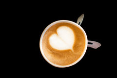 Coffee. Top view a paper cup of coffee with heart shape on Black background Royalty Free Stock Photos