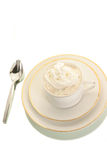 Coffee topped with whipped cream. Hot coffee topped with cool whipped cream isolated on white Royalty Free Stock Photo