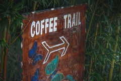 Coffee Trail. This sign leads down a trail in a former coffee farm in Costa Rica Royalty Free Stock Images