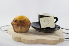 Coffee on tray with muffin with white background, with one post- stock images
