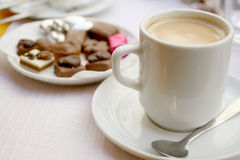 Coffee and truffles. Delicious truffles and coffee stock photos