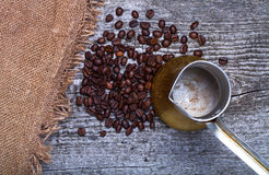 Coffee turk and coffee beans on old gray wooden table with burla Royalty Free Stock Image