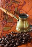 Coffee in turk, grains and map Royalty Free Stock Image