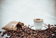 Coffee turk and roasted beans on burlap background Royalty Free Stock Image