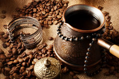 Coffee turk. Coffee turk still life on a sackcloth background Royalty Free Stock Photography