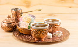 Coffee and Turkish delight in a copper cups. Coffee and Turkish delight in a copper kitchen utensils stock images