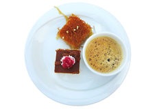 Coffee with Turkish sweets seved on white plate isolated Royalty Free Stock Photos