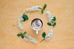 Coffee and twigs of blooming bird cherry Stock Images