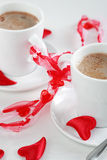 Coffee for two. Two cups of coffee, bonded with red bow, Valentine motive Royalty Free Stock Image