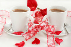 Coffee for two. Two cups of coffee, bonded with red bow, Valentine motive Stock Photo