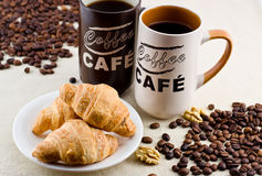 Coffee. Two cups of coffee with croissants and elements walnuts Stock Photos