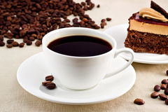 Coffee. Two cups of coffee with croissants and elements walnuts Royalty Free Stock Photography