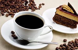 Coffee. Two cups of coffee with croissants and elements walnuts Stock Image