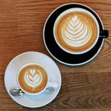 Coffee for two. Two cups of coffee with latte art Royalty Free Stock Photography