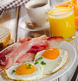 Coffee , Two  eggs  and bacon for healthy breakfast Stock Photos
