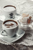 Coffee for two. Two Turkish coffee and Turkish delight on table Royalty Free Stock Photo