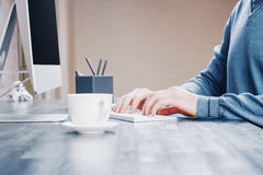 Coffee and typing hands Royalty Free Stock Photos