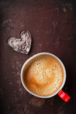 Coffee in unusual vintage tin mug with glass heart Stock Photos