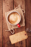 Coffee in unusual vintage tin mug with grunge paper tag Stock Images