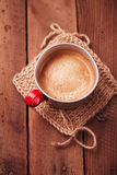 Coffee in unusual vintage tin mug with red handle Stock Photo