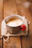 Coffee in unusual vintage tin mug with red handle Royalty Free Stock Images