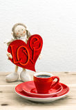 Coffee and Valentines Day decoration. Doll girl with LOVE Stock Image