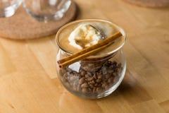 Coffee with vanilla ice cream. On wooden table Stock Image