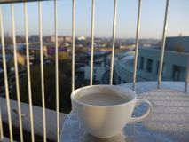 A coffee with a view. Coffee on a frosty table overlooking camden lock in london Stock Images